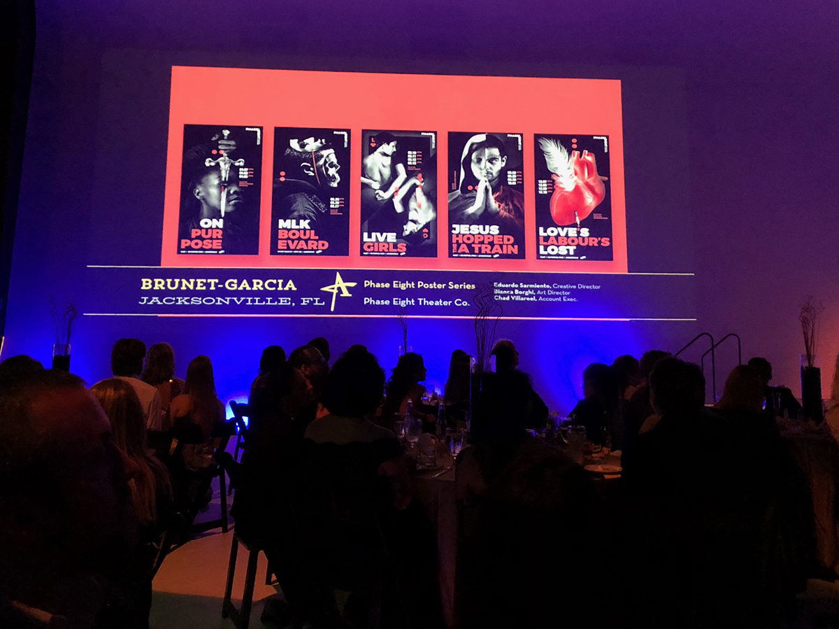 A view of the screen projecting the five posters at the awards ceremony.
