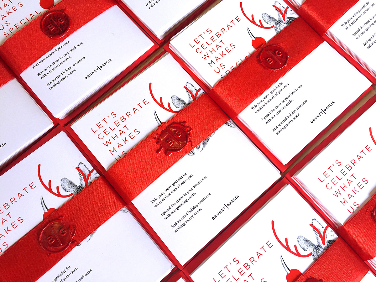 Bunches of holiday cards wrapped in ribbons.