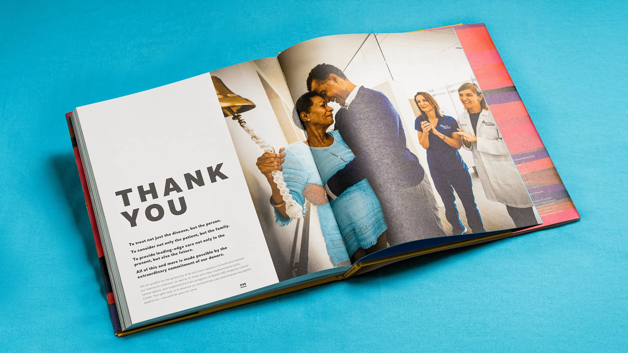 Spread of the book thanking donors with a heartfelt photo of a cancer survivor embraced by her husband