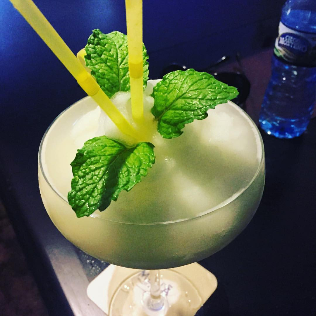A daiquiri with mint leaves.