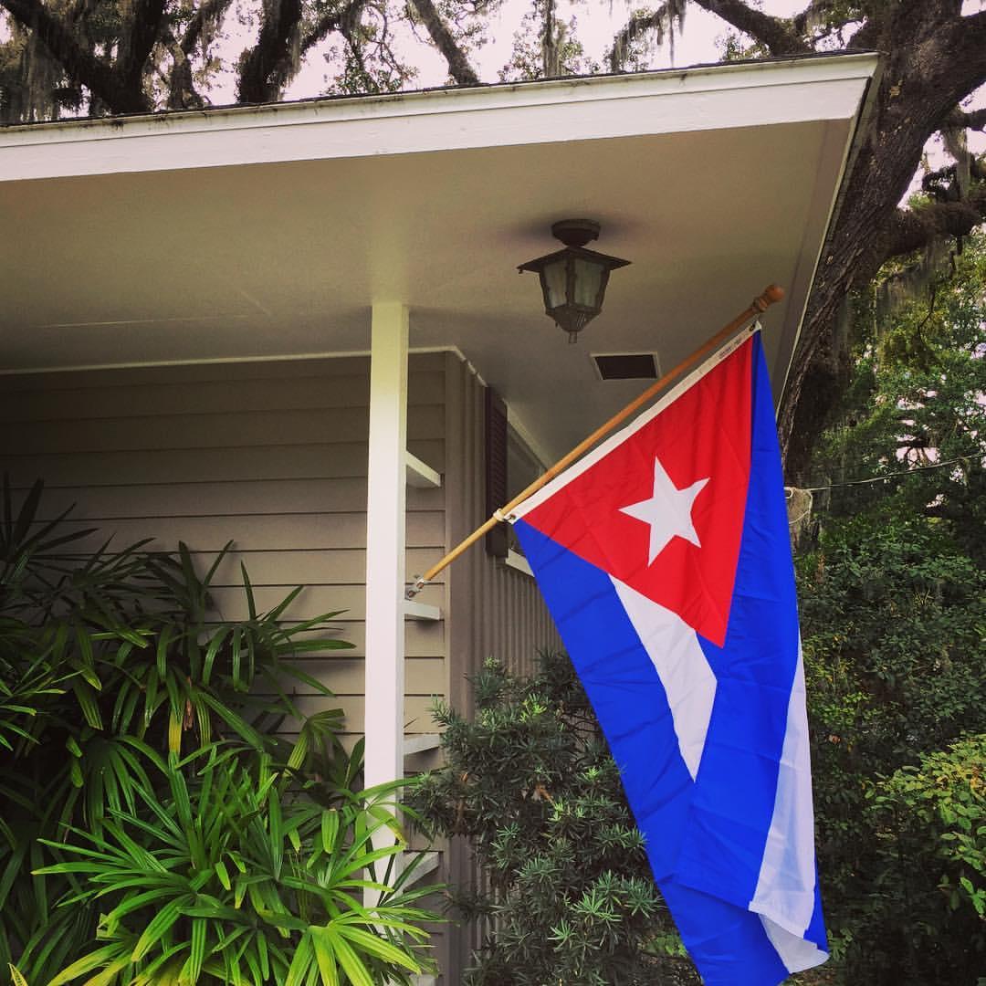 Jorge Brunet-García flies the Cuban flag after Fidel Castro dies.