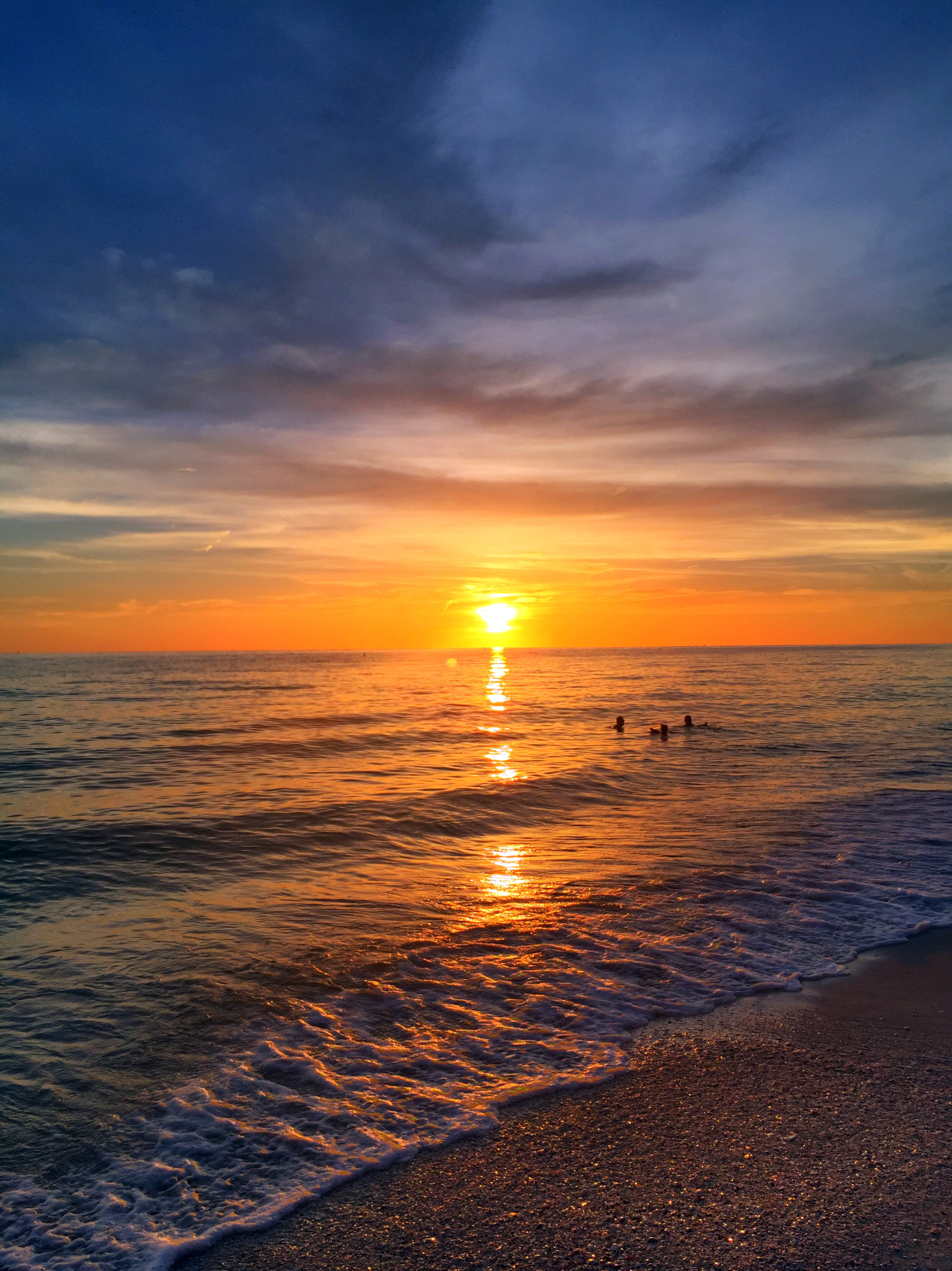 Denise M. Reagan captures a sunset on Sunset Beach near St. Petersburg courtesy of a summer half-Friday.