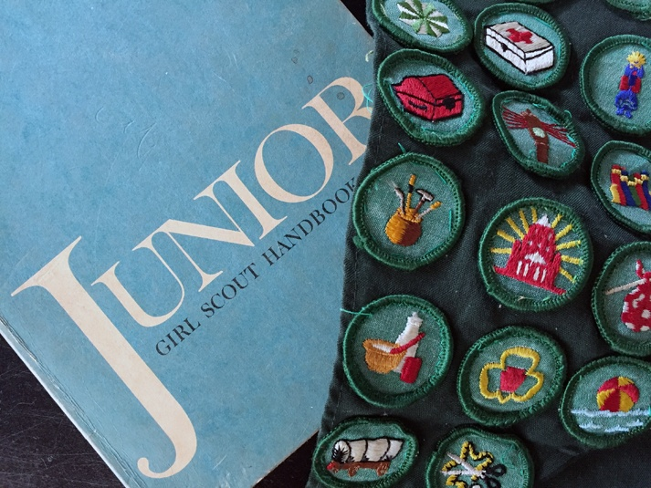 Girl Scout badges and handbook.