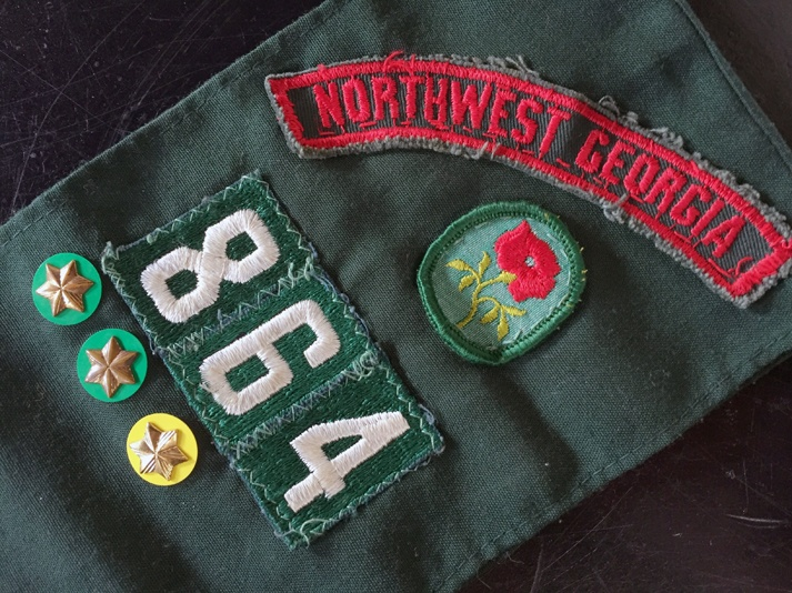 Girl Scout Troop 864 badges on sash.