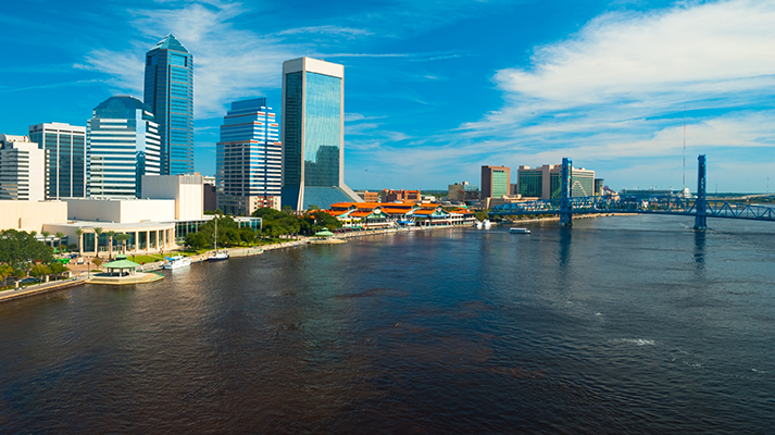 (Elevated) Aerial view of the Jacksonville downtown skyline, St. Johns River, and the Main Street Bridge.