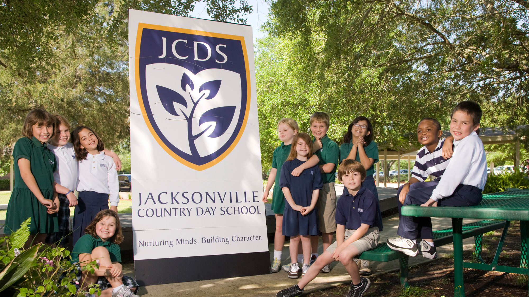 Jacksonville Country Day School logo on a banner surrounded by children