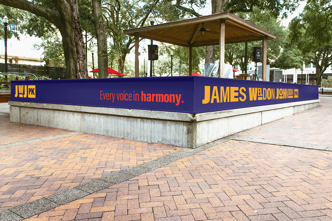 James Weldon Johnson Park signage that reads: Every voice in harmony.