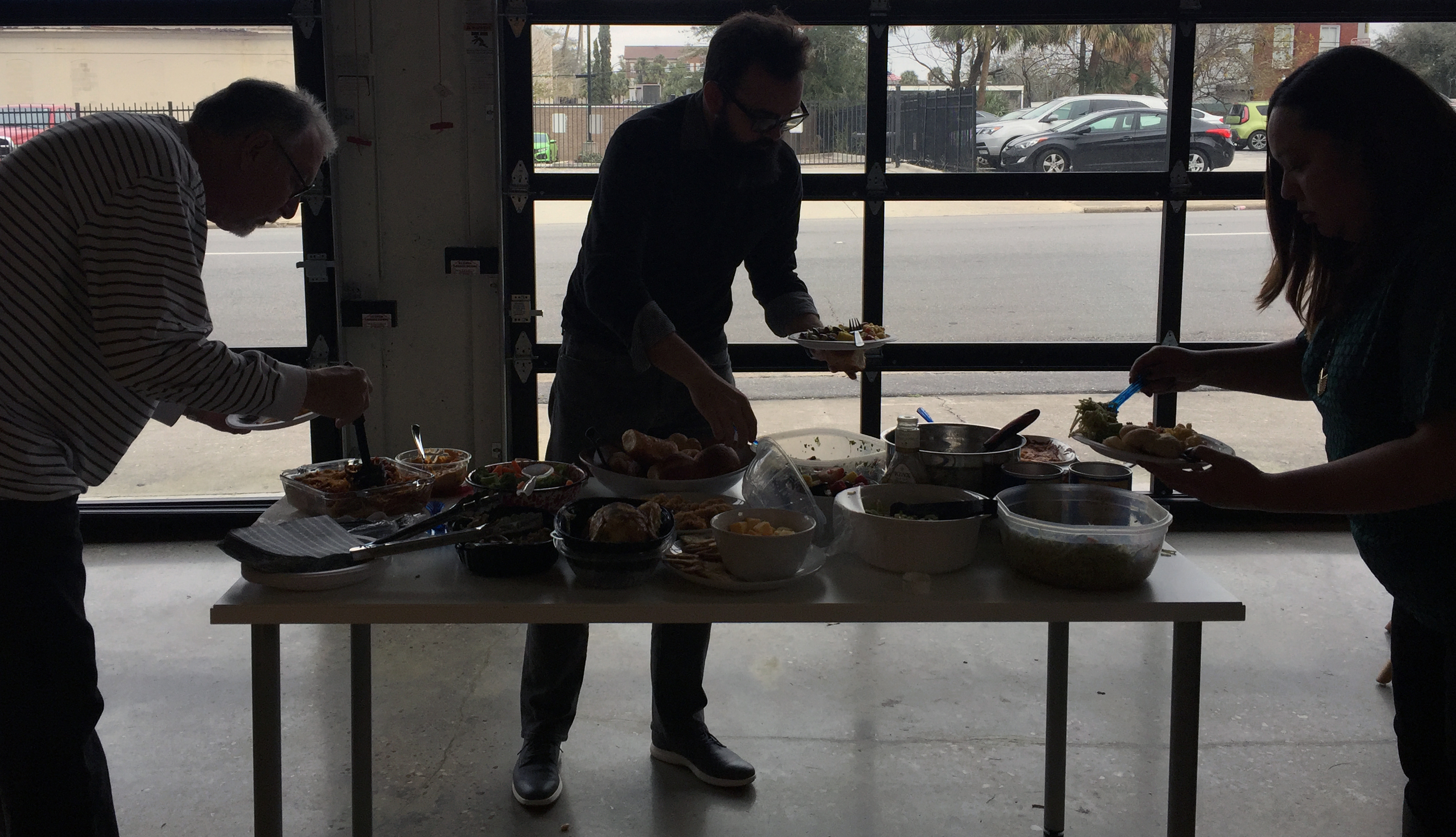 Employees serve themselves at a Lunchathon potluck.