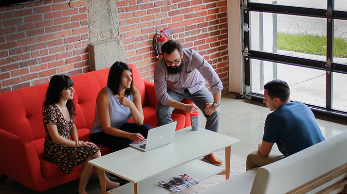 Cassie Deogracia, Kate Jolley, Eduardo Sarmiento, and Chad Villarroel get to work at Level Office in Downtown Jacksonville. Photo by Bianca Borghi.