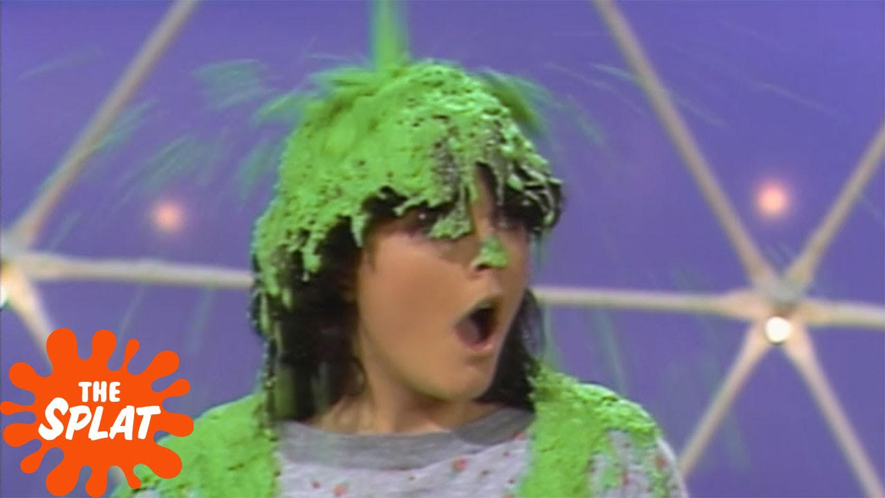 Green goo splats on a young person on Nickelodeon.