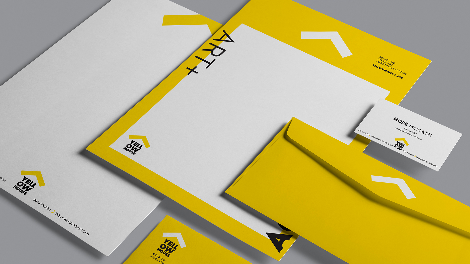 Yellow House stationery, including letterhead, envelope, and business card.