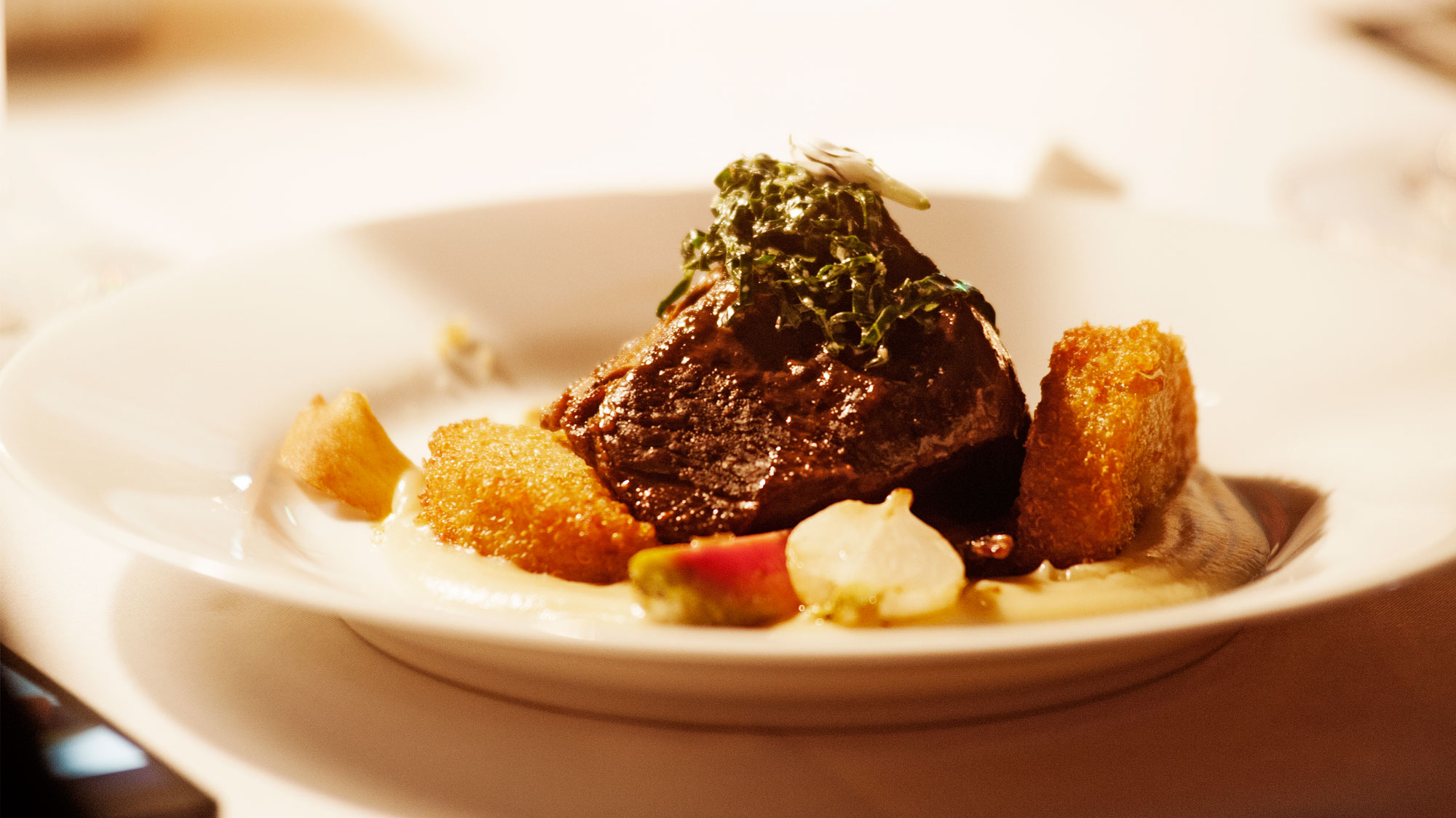 beef short ribs with crispy quinoa in a parsnip puree