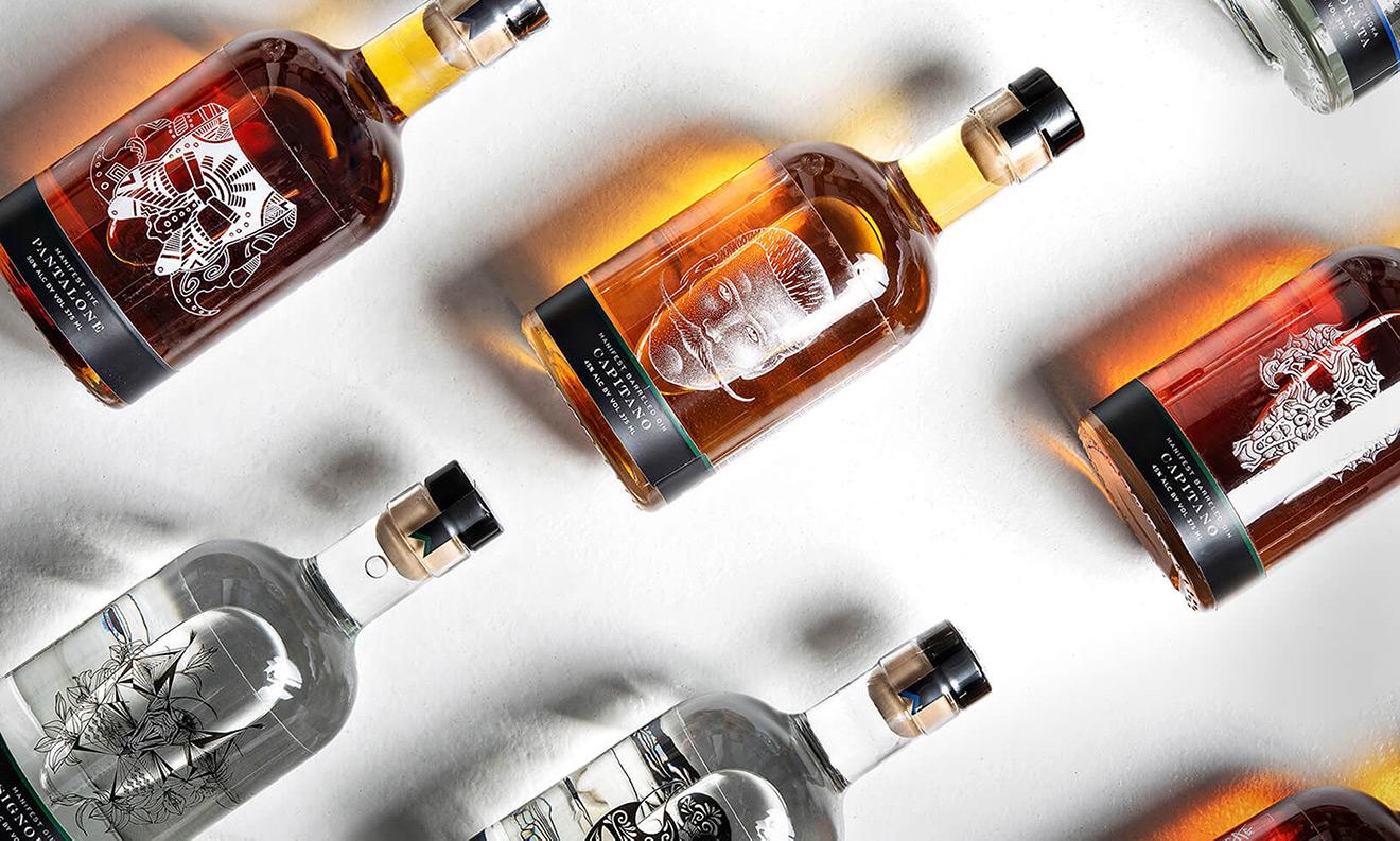 Stage Fund & Manifest Distilling bottles showing the different designs