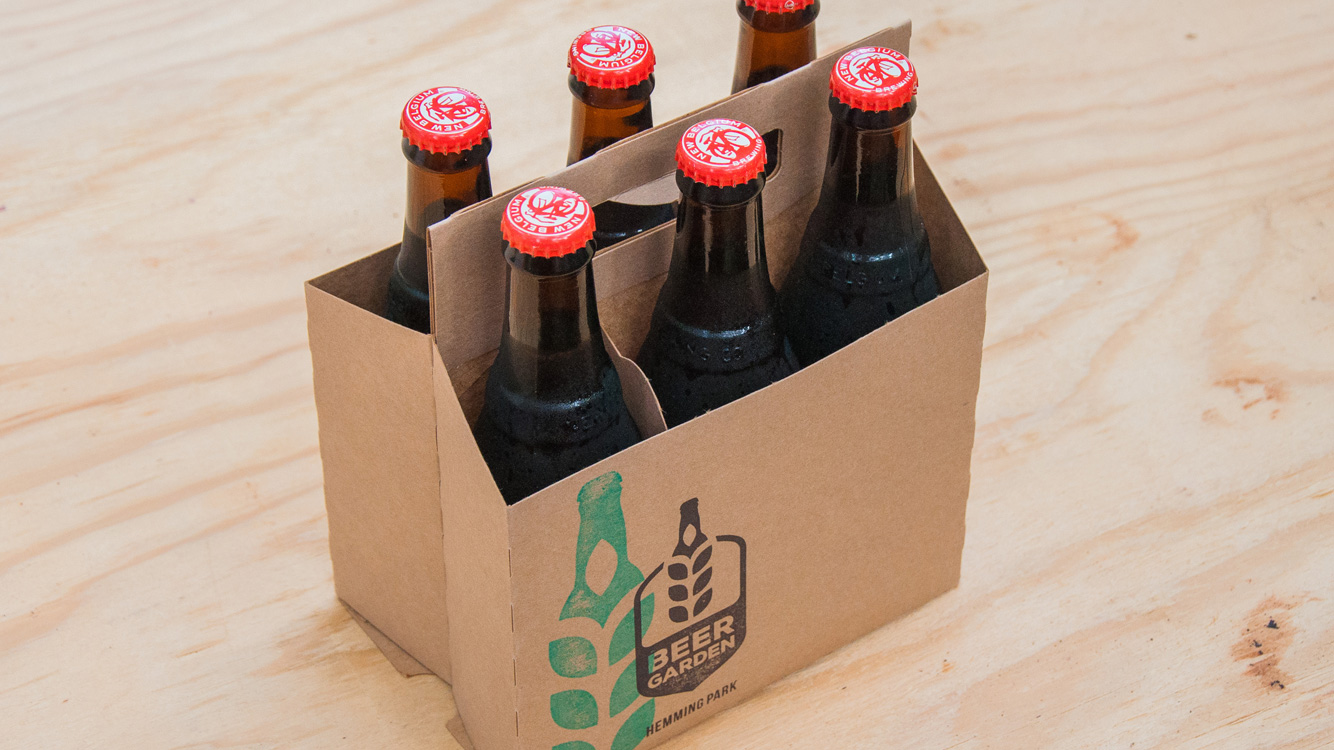 sixpack carrier with the Beer Garden logo on it