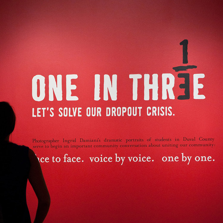 "exhibit statement that reads: ""One in three. Let's solve our dropout crisis."""